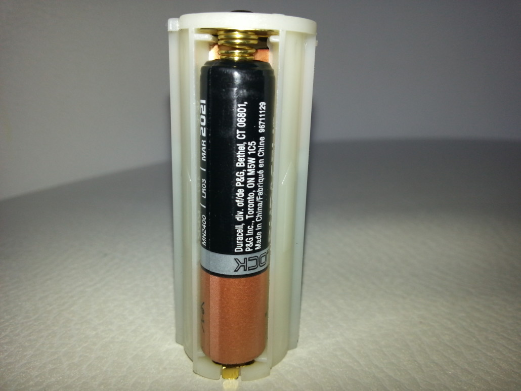 AAA Batteries Inside A PeeDar Battery Caddy